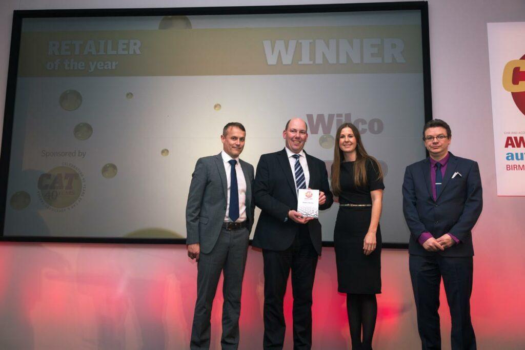 Richard accepts award